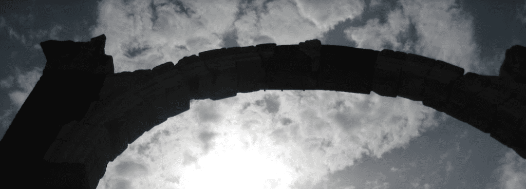 Gate archway against a cloudy sky
