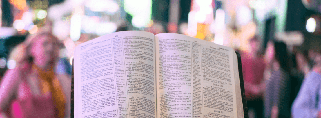 Person reading God's Word in the street
