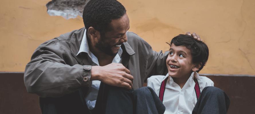 Man mentoring a child